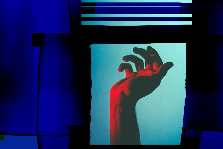 glowing hand reaching out through an deep blue frame
